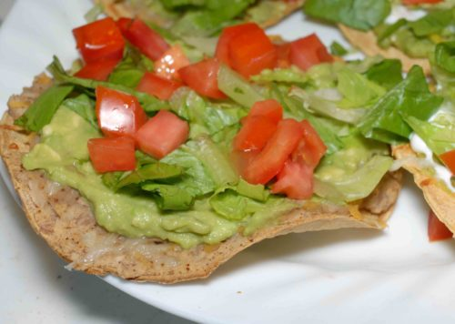 Avocado tostadas with refried beans