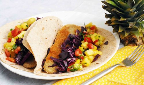 Fish tacos with pineapple salsa and red cabbage slaw