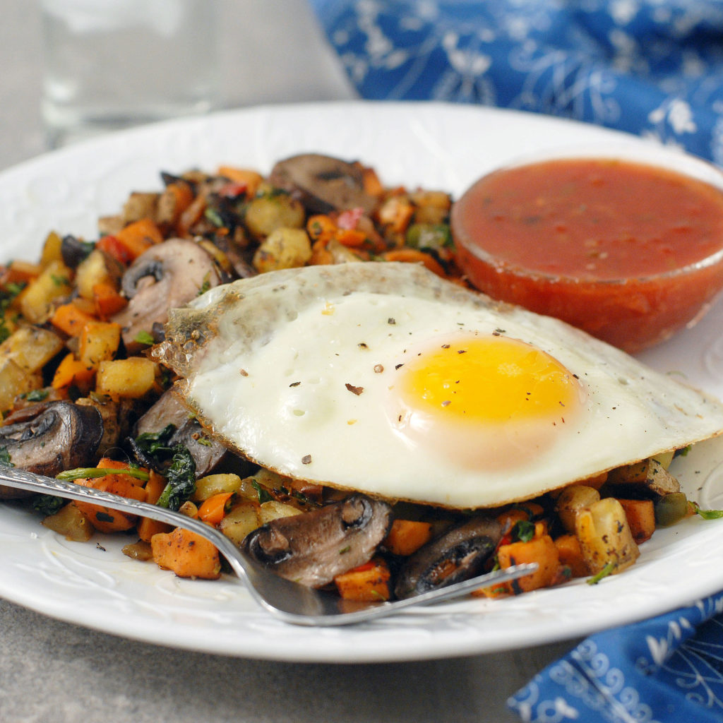Two potato hash with mushrooms and fried eggs by Alison's Allspice